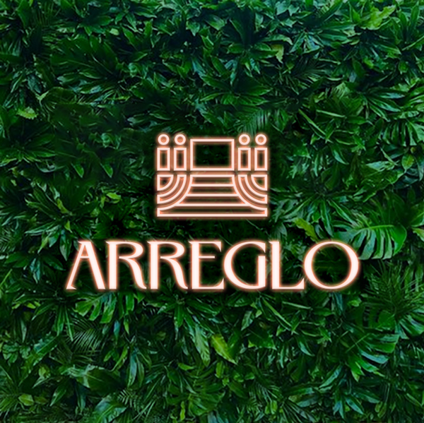 Arreglo Logo as a neon sign on a plant wall