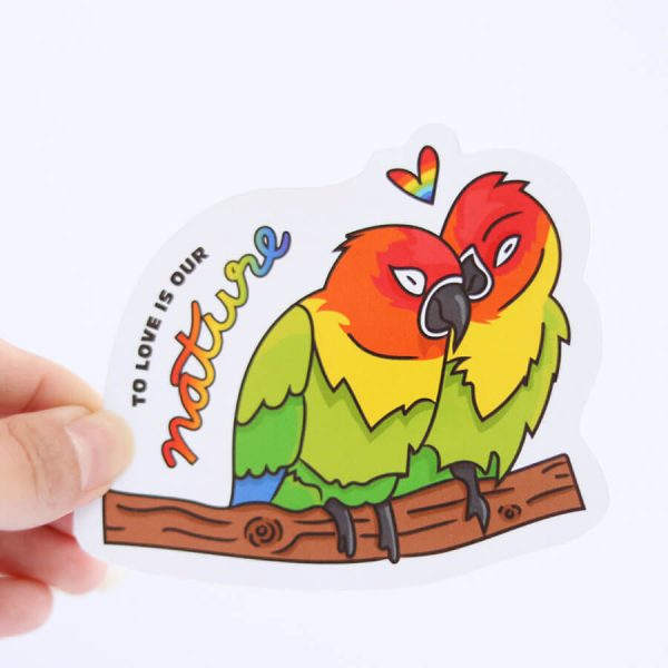 To Love is Our Nature Sticker   Holding with Fingers   Ash Robertson Design   Love Birds LGBTQ+ Pride