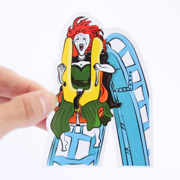 Banshee Rollercoaster Sticker | Holding with fingers | Ash Robertson Design