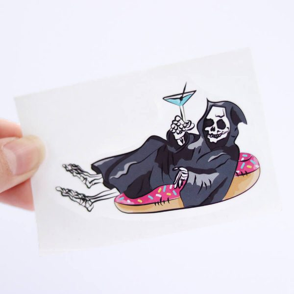 Grim Reaper on a Pool Floaty Sticker (Small) | Holding with fingers | Ash Robertson Design