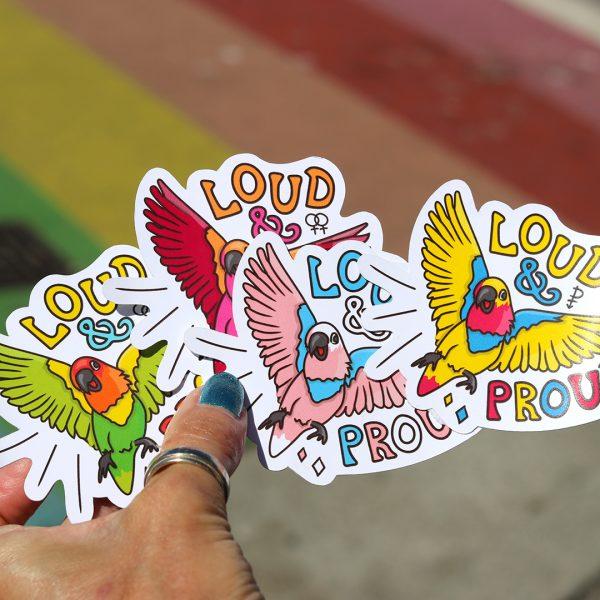 Love Birds Bundle | All Pride Stickers for $25 | Holding against rainbow crosswalk Davie St. Vancouver