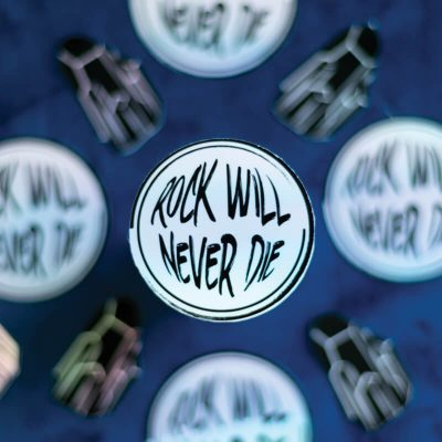 Rock Will Never Die Sticker (Holographic) | Patterned Backdrop | Ash Robertson Design