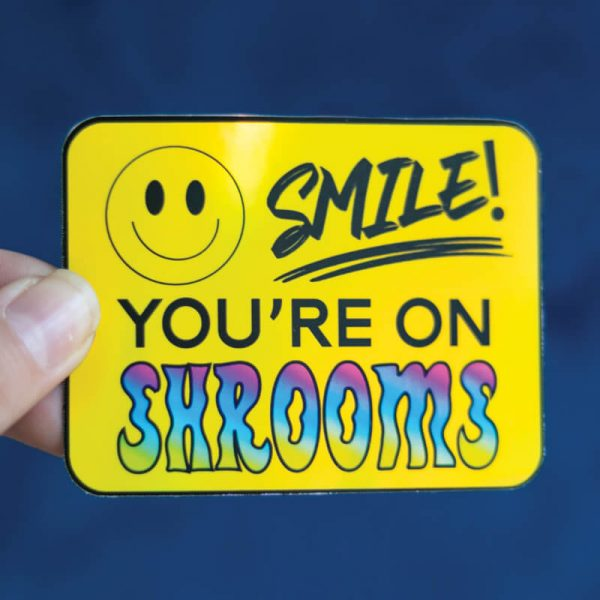 Smile! You're On Shrooms Sticker (Holographic) | Holding with Fingers (Straight On) | Ash Robertson Design